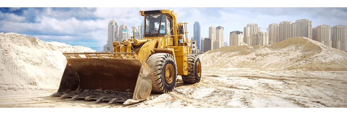 Трактор песок